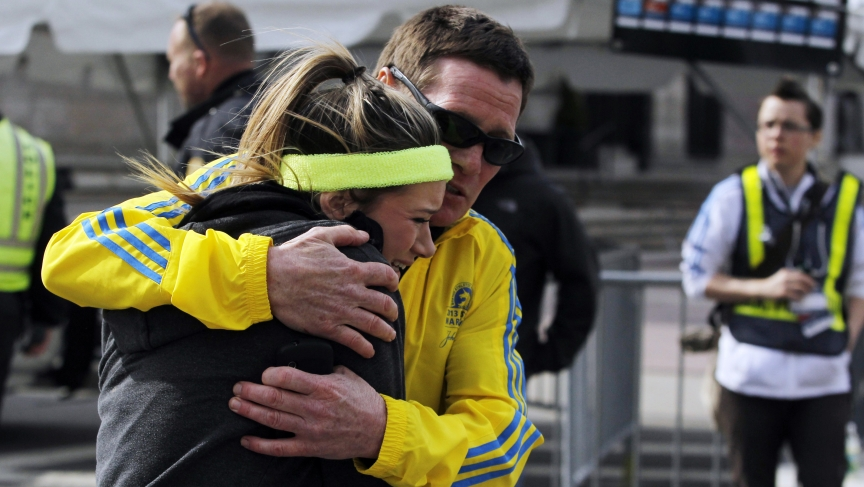 A woman is comforted by a man near a triage tent set up for the Boston Marathon after the April 2013 bombings
