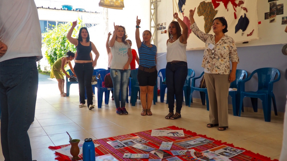 Bolivian, Colombian, Venezuelan and Peruvian immigrants participate in a team-building activity before their community organizing training at CAMI.