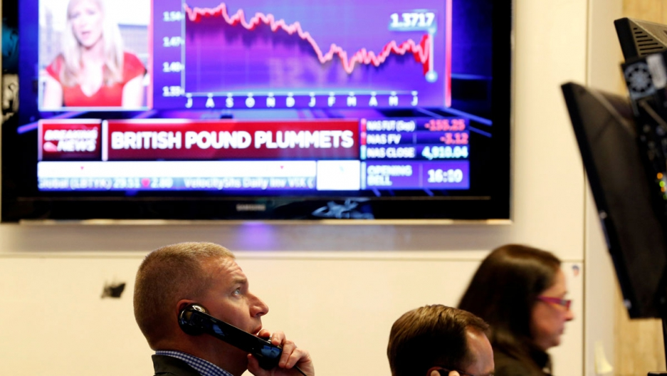 Traders work on the floor of the New York Stock Exchange before the opening bell, June 24, 2016.