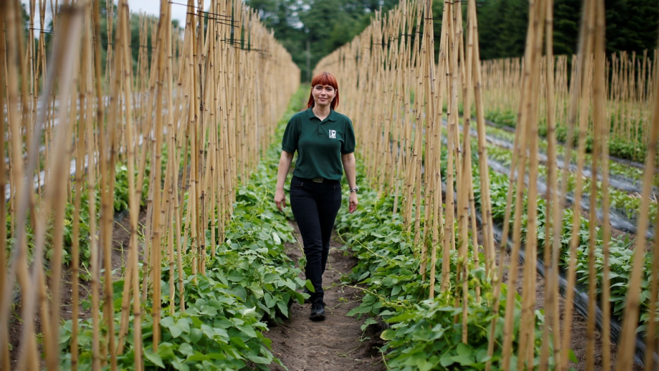 "Raluca Cioroianu from Romania poses for a photograph at the farm where she is a shop manager in Addlestone, Britain. ""I came here with good intentions, to work, to pay taxes, to improve my knowledge, my culture and to make a better life,"" said Cioroianu."