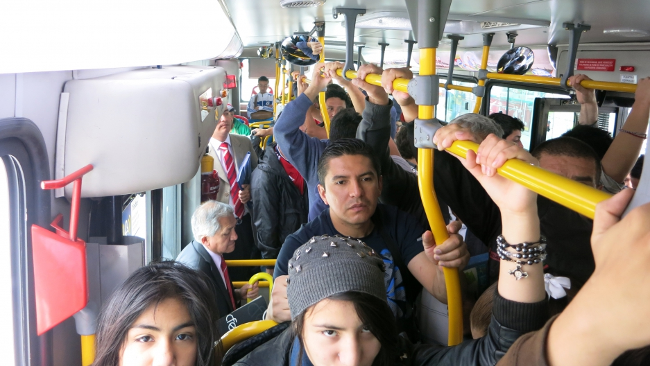 Standing passengers on a crowded bus in Bogotá might not feel so lucky, but at least they're burning more calories than people who sit during the commute.