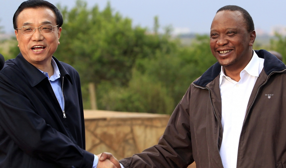 Kenya and China have developed a closer economic relationship in recent years. Chinese Premier Li Keqiang (left) shakes hands with Kenyan President Uhuru Kenyatta in May 2014.