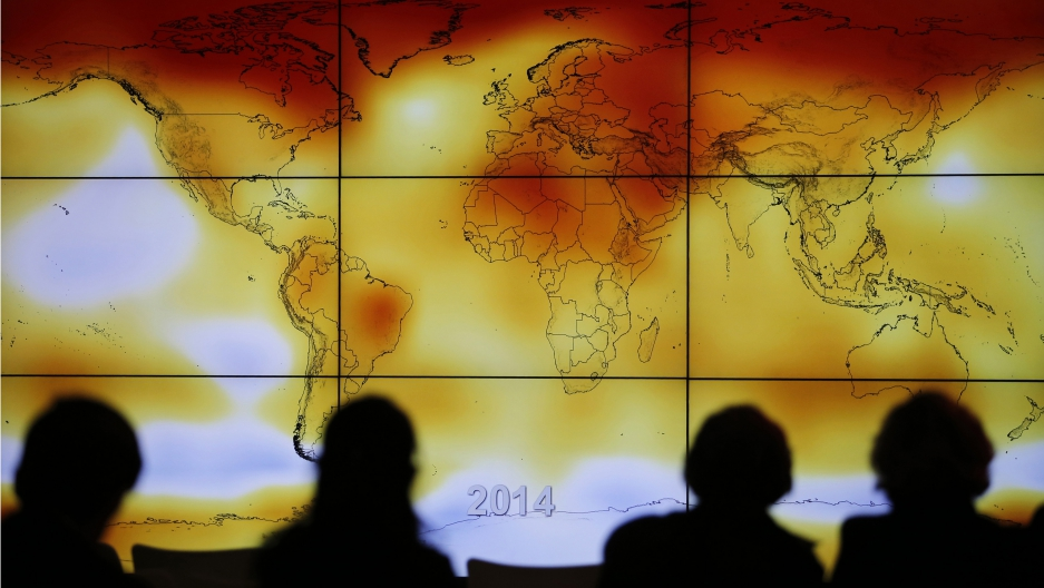 Participants view a world map with climate anomalies during the World Climate Change Conference 2015 (COP21) at Le Bourget, near Paris. The conference is charged with producing a consensus agreement between 195 countries to limit the dangerous warming of