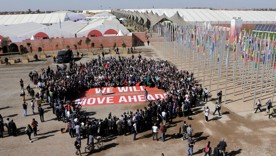 Greenpeace activists stage a protest outside the UN Climate Change Conference in Marrakech, Morocco.