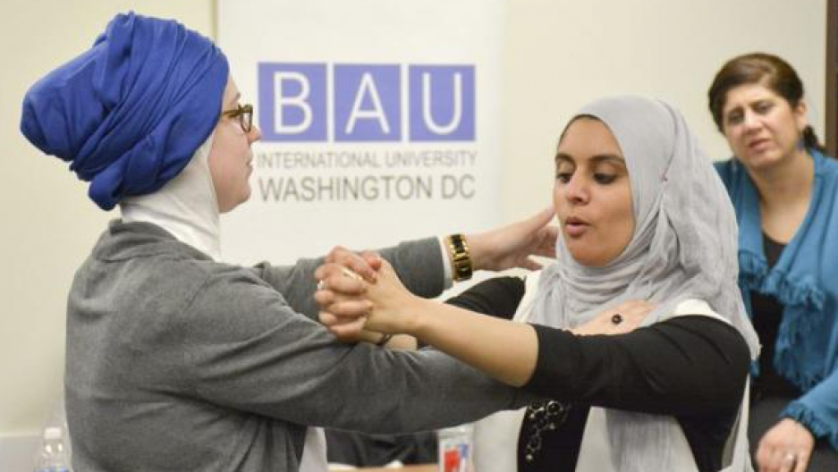 Rana Abdelhamid (C) demonstrates a move to a student during a self-defense workshop designed for Muslim women in Washington, DC, in March.