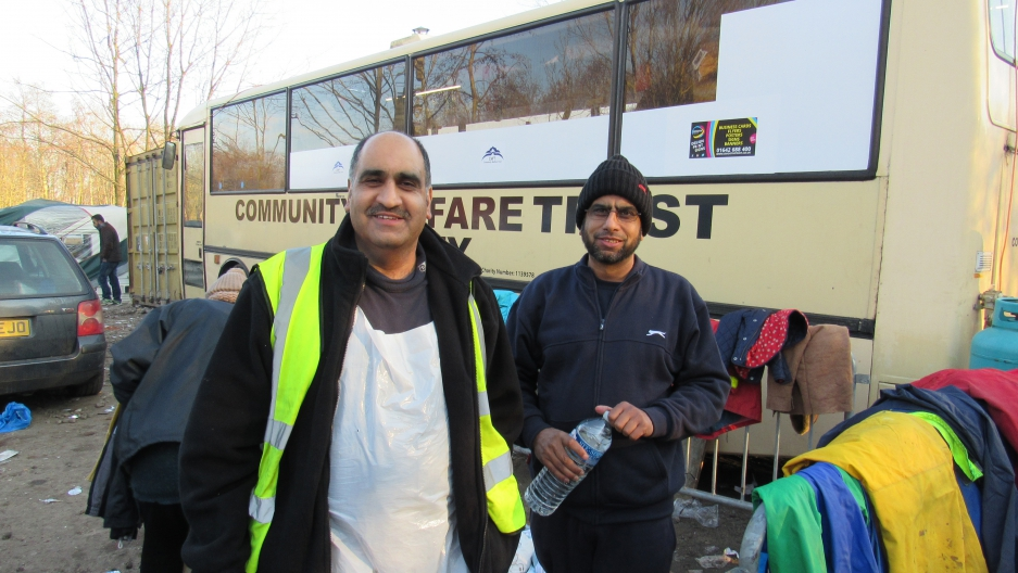 Ghafoor Hussain and his brother Fazel outside Ghafoor's bus-turned-mobile kitchen. They're supplying 3,000 hot meals a day, and 10,000 cups of tea.