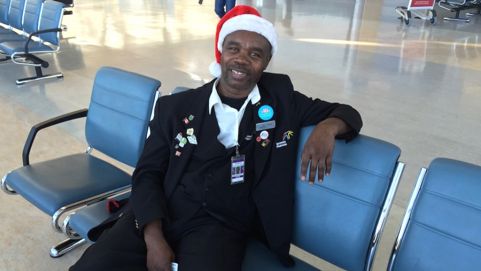 Ivan Watson greets travelers at Toronto's Pearson Airport with a smile, and often a song. It's not what you usually get as you wait to get through airport security.