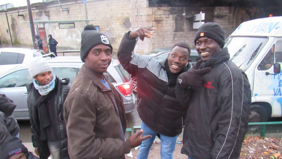 Abdallah Khalil (right) with friends in northern Paris. Khalil arrived in Paris in December and hopes to get asylum in France.
