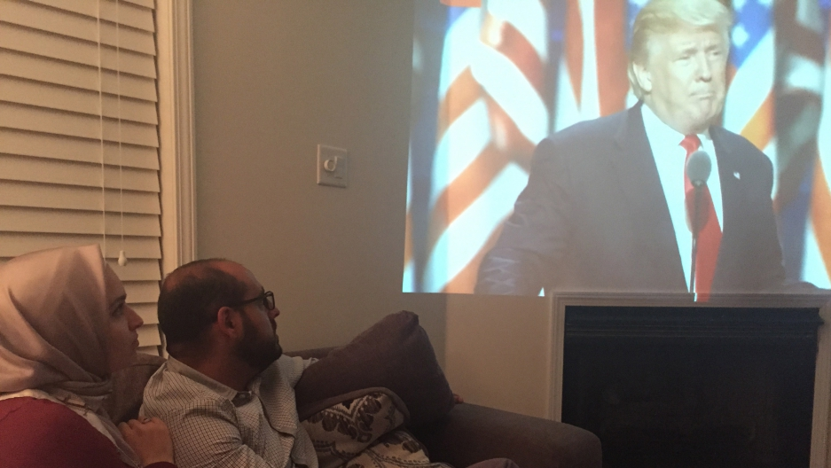 Marwah Maasarani and her husband Omar Awad watching Donald Trump's RNC speech in their New Jersey livingroom on Thursday.
