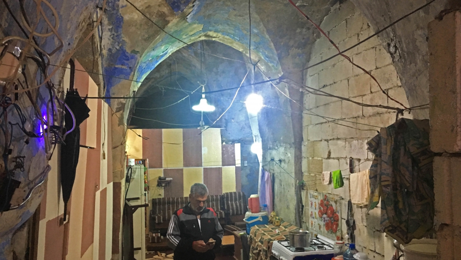 Jihad Al-Mohammed in his home in Saida. When he moved in, the centuries-old building was abandoned, but it used to be a Jewish synagogue.