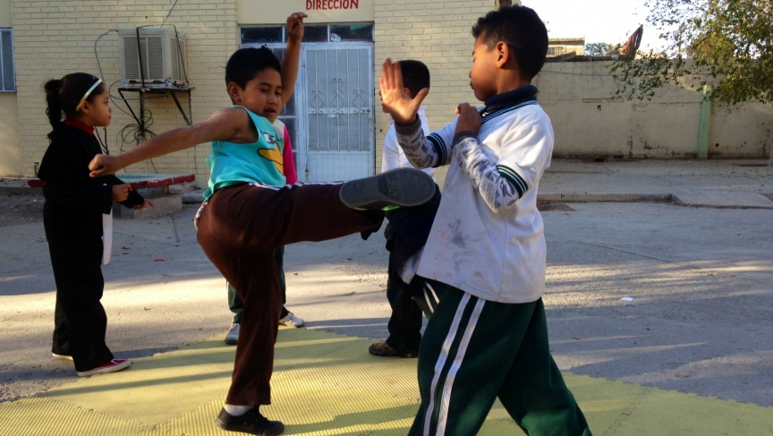 Children practice tae kwon do at an after school program in Cuidad Juárez, funded by the Merida Initiative.