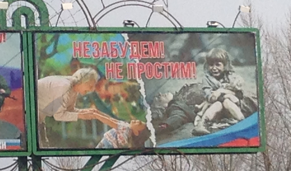 "A manufactured story in Eastern Ukraine. The billboard reads, ""We won't forget, we won't forgive,"" but Antelava says the photo of the girl has been faked."