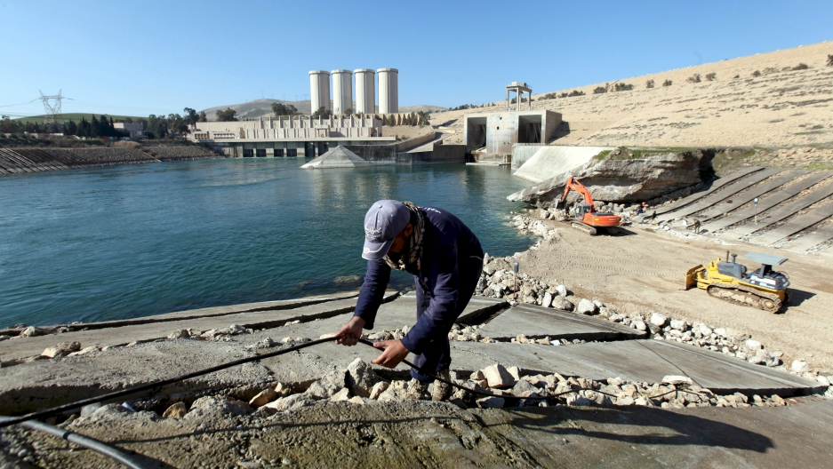 An employee works at strengthening the Mosul Dam in northern Iraq, in February 2016.