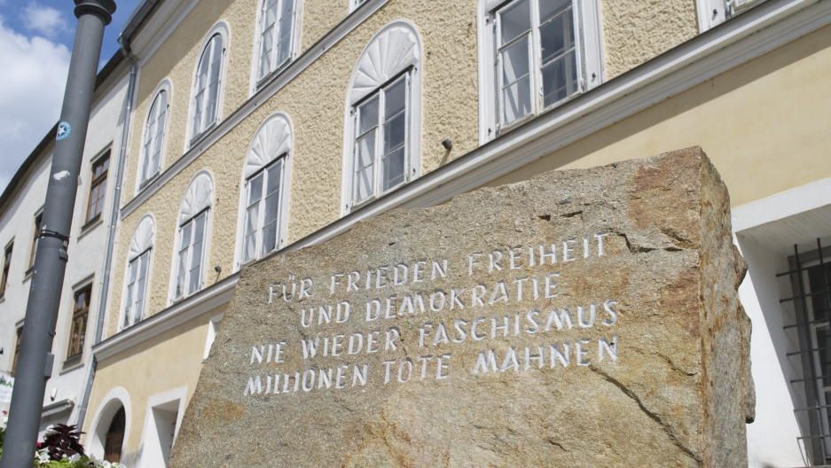 """Outside the house in Austria where Adolf Hitler was born there's a block of stone from the Mauthausen concentration camp. It reads """"for peace freedom and democracy, never again fascism, remember the millions of dead."""""""