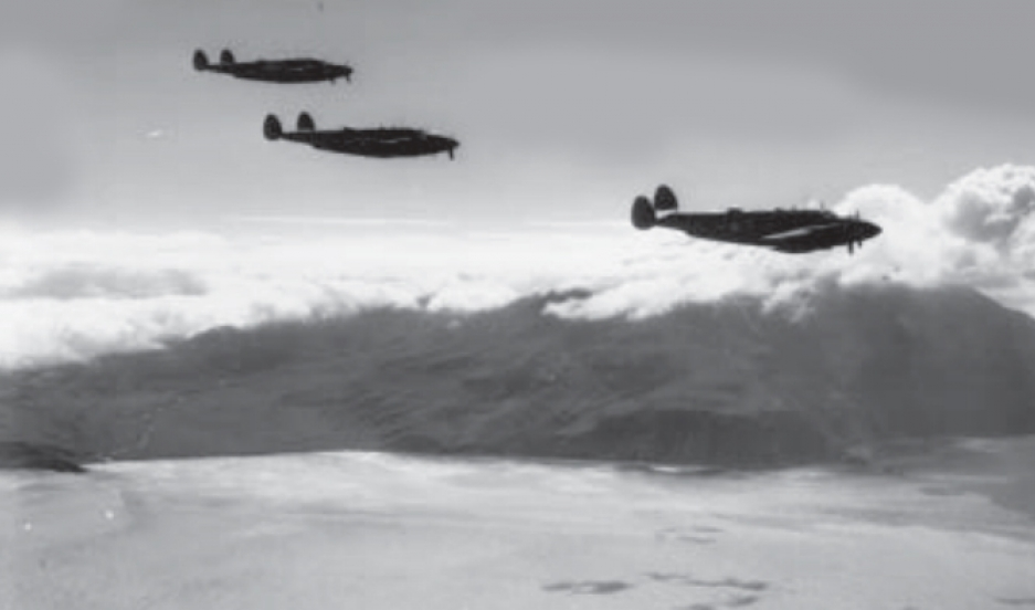 Three PV-1 planes fly by Kiska Volcano during the Allied invasion of Kiska on August 15, 1943.