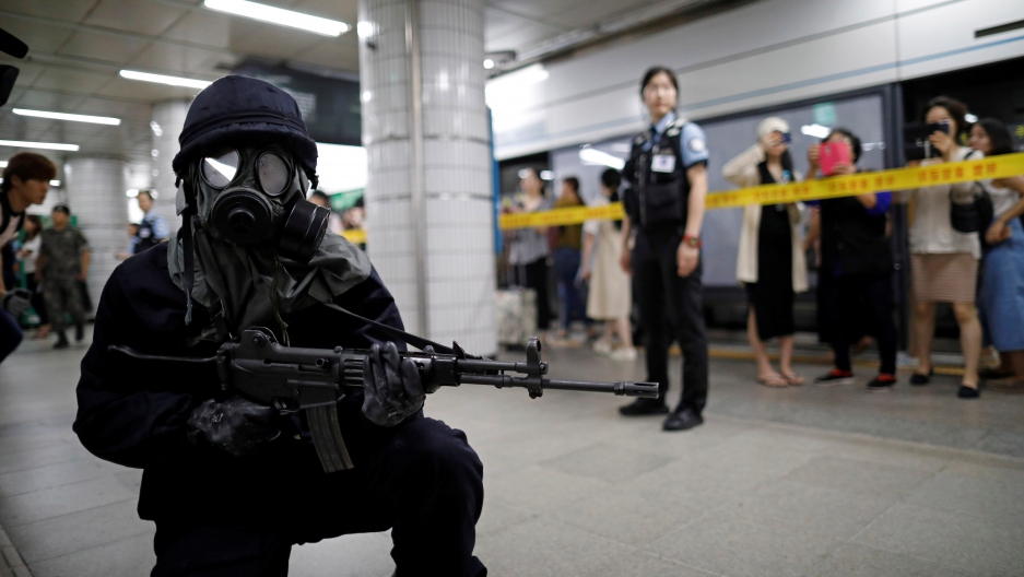 A South Korean policeman takes part in an anti-terror drill as part of the Ulchi Freedom Guardian exercise in Seoul, South Korea, August 22, 2017.