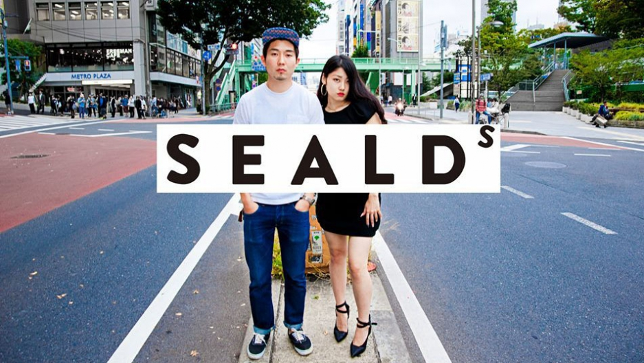 An eye-catching poster from the student group SEALDs, featuring founding member, Wakako Fukuda (right).  SEALDs (Students Emergency Action for Liberal Democracy) has changed the image of protesters in Japan, and made it okay to speak out.