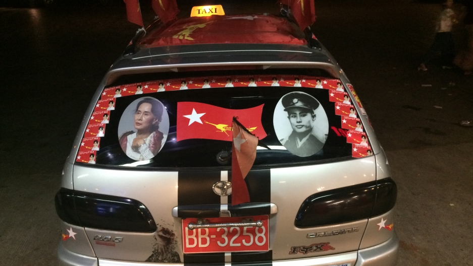 A taxi in Yangon decorated for Myanmar's election: a picture of Aung San Suu Kyi (l), and her late father, Aung San (r), who is revered as the father of modern Burma.