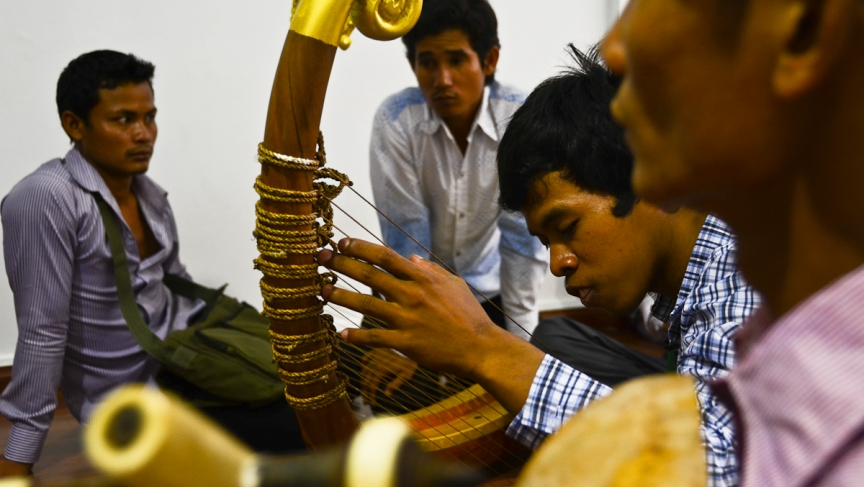 A musician strums the pin, the Cambodian harp, during a rehearsal in Phnom Penh.