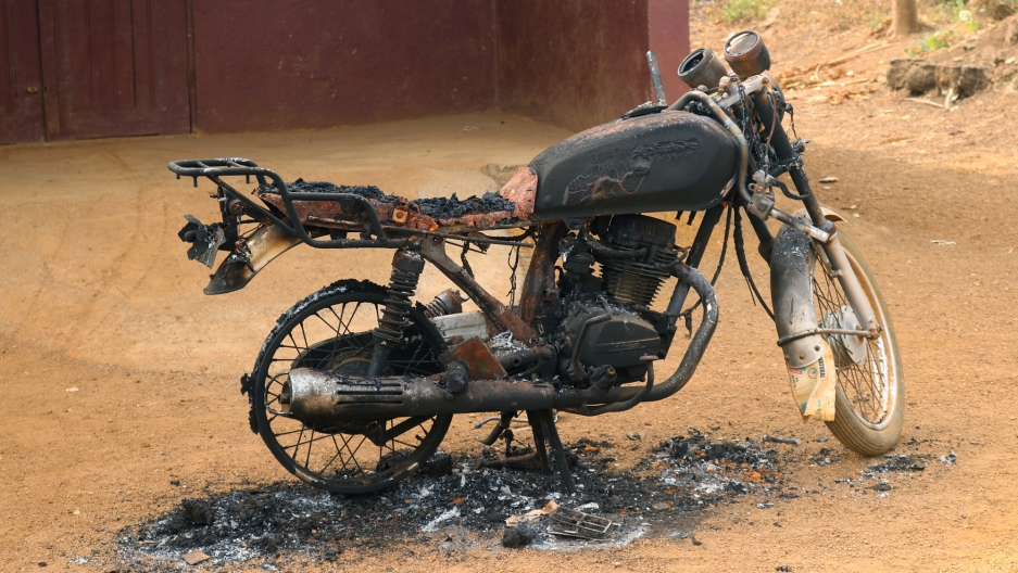 A burned and destroyed motorcycle is seen in Kembong, south-west region of Cameroon Dec. 29, 2017.