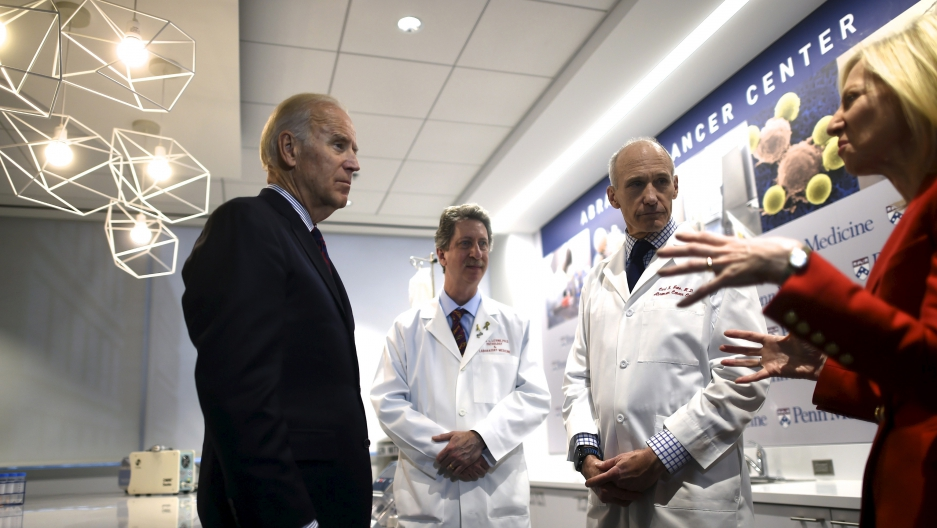 Vice President Joe Biden (L) meets with (C-R) Dr. Bruce Levine, Dr. Carl June, and University of Pennsylvania President Amy Gutmann while touring the University of Pennsylvania, Perelman School of Medicine and Abramson Cancer Center. During the State of t