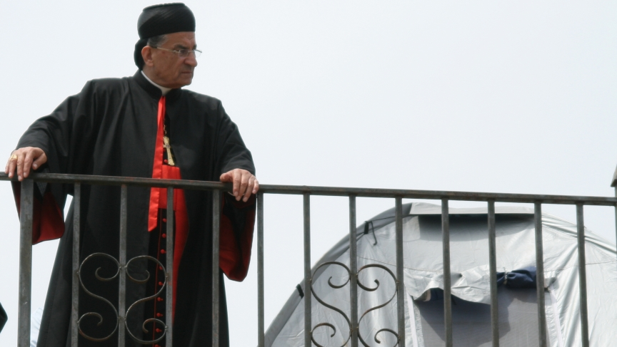 Lebanese Maronite Cardinal Bechara Rai looks over the ruins of Kfar Biram from the top of the village's church in northern Israel. Activists have been living in tents on the site for months to pressure Israel to rebuild the destroyed community.