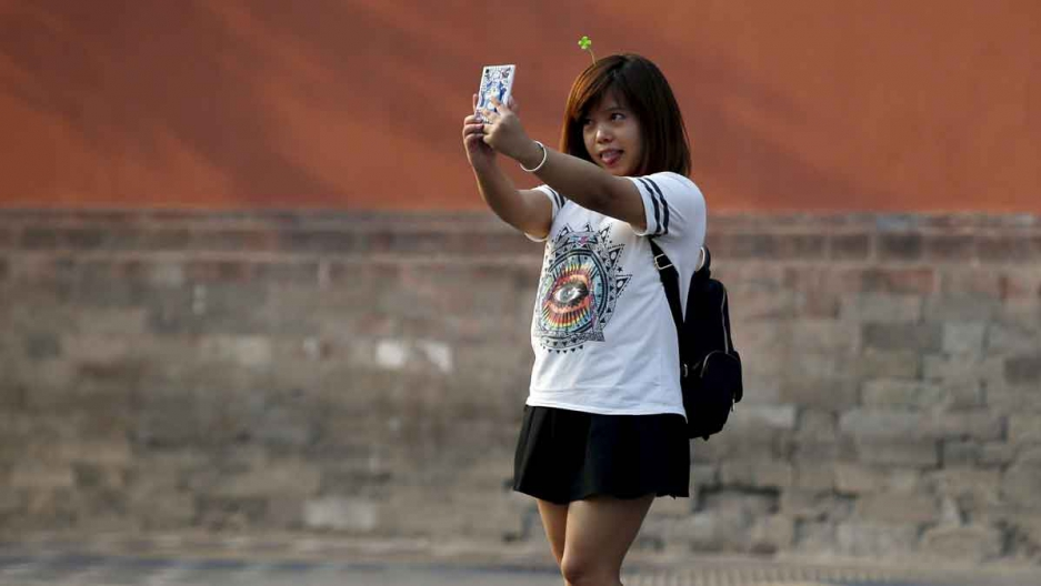 A woman takes a selfie in Beijing, September 2015.