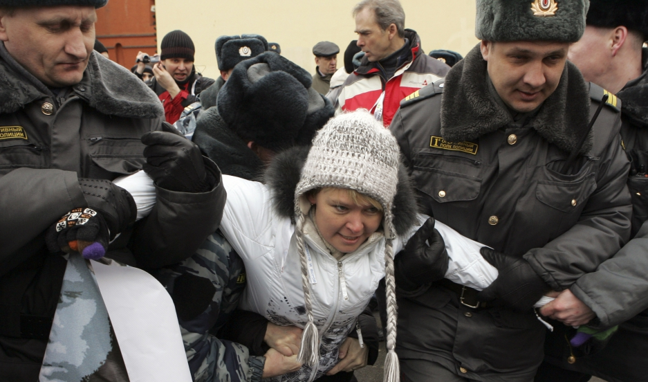 Police detain environmental activist Evgenia Chirikova during an opposition rally in Moscow in 2012. Chirikova's efforts to save a protected forest ultimately made her a leading critic of the Russian government. Now after years of pressure from the govern