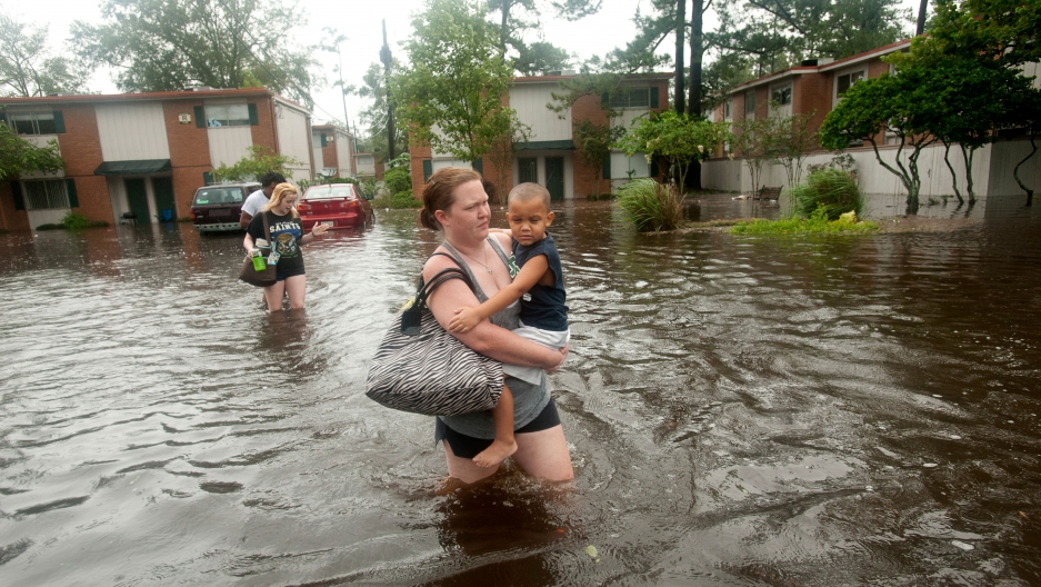 A woman wades through flood water in New Orleans