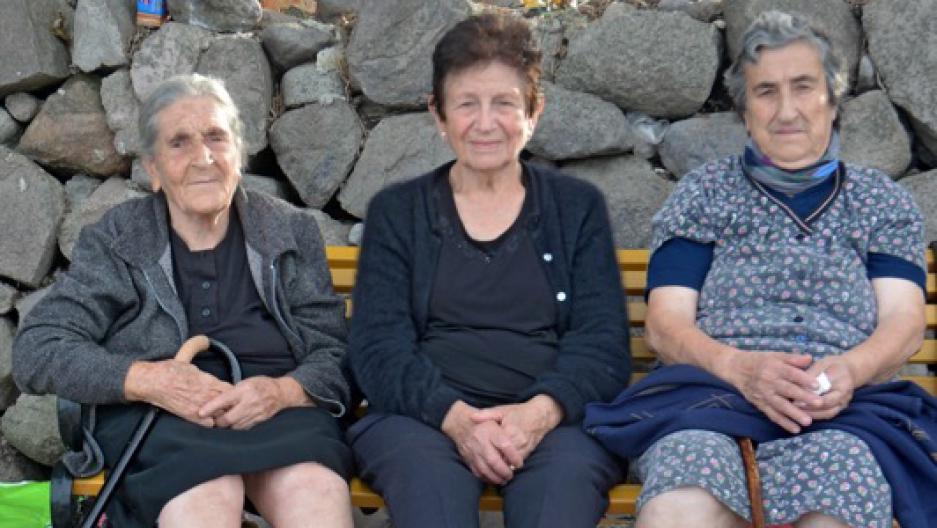 Constantina Mesisklis, center, and two friends at Skala Sykaminia in Lesbos, Greece.