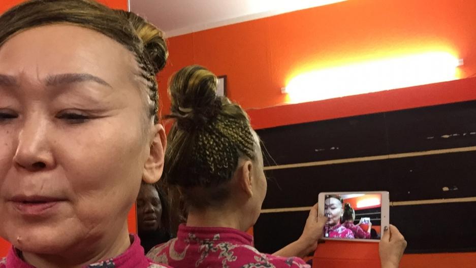 Sainkho Namtchylak takes a selfie of her cornrows.
