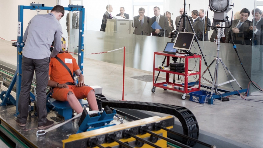 An engineer readies a crash test dummy at Spain's TESSA testing facility.