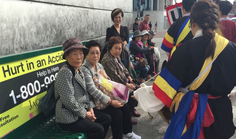 Korean grandmas get a surprise drum line performance while waiting for the bus in LA's Koreatown. The drumming celebration is now popular in Los Angeles, but it wasn't so much when it first started there in the late 1980s.