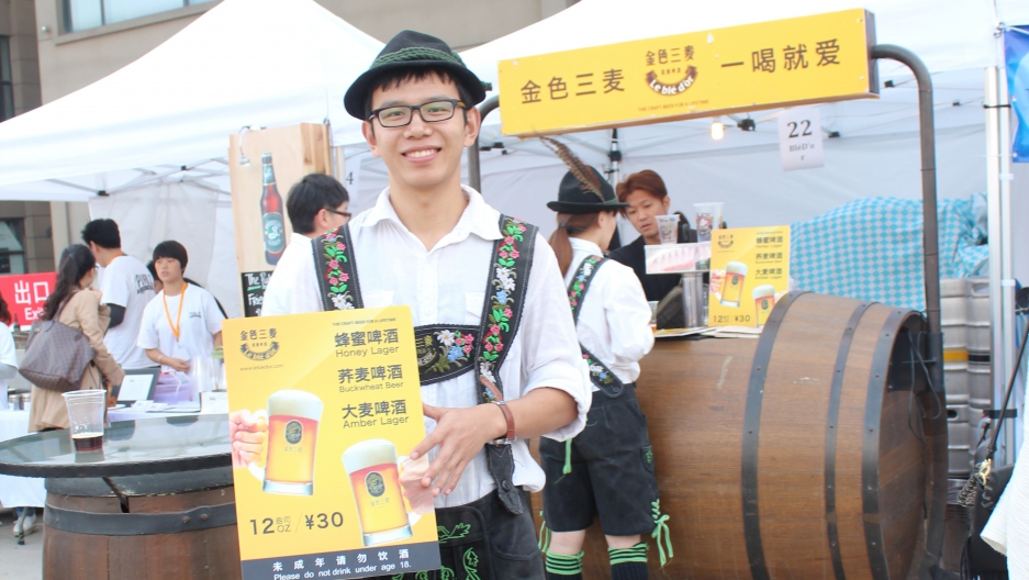 At the Shanghai Beer Fest, a waiter for a local brewer sports lederhosen. China is becoming more of an international beer market.