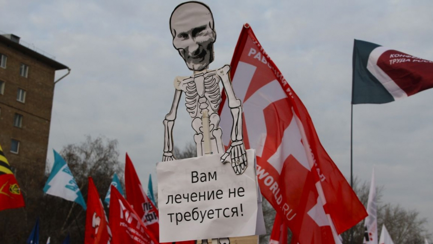 "At Sunday's protests against hospital closures and medical layoffs in Moscow, one sign featured Putin as a skeleton. The sign reads: ""You don't need treatment."""