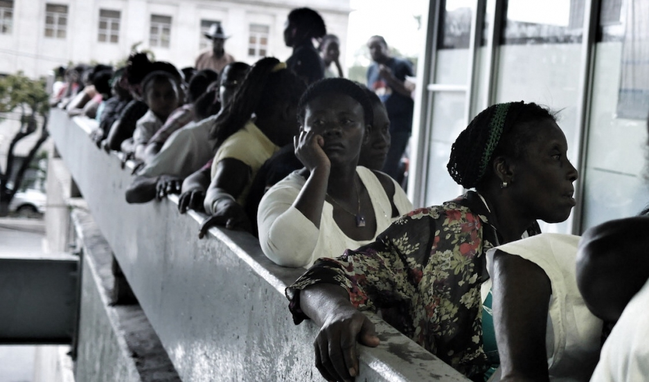 """The waiting line at El Huacal, the government building in Santo Domingo where undocumented Haitians (and Dominicans of Haitian descent) have come to """"regularize"""" their status."""