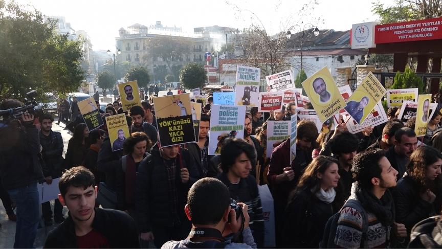 "A student-led protest marches to Istanbul University's Faculty of Arts and Sciences with a banner that reads, ""Through the imagination to the Power"" and ""From Campus to Kobane""."