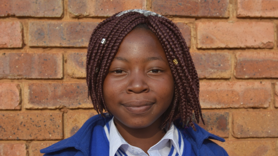Close-up of the face of Nhlanhla, an HIV positive teen mom in South Africa.
