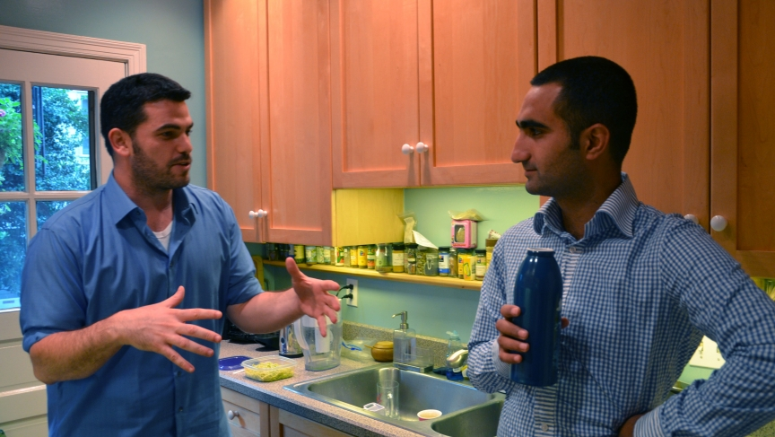 Yehonatan Toker (left) and Hamze Awawde (right) in their kitchen in Washington, DC. Toker, an Israeli, and Awawde, a Palestinian, are in Washington for internships, and they're sharing a house.