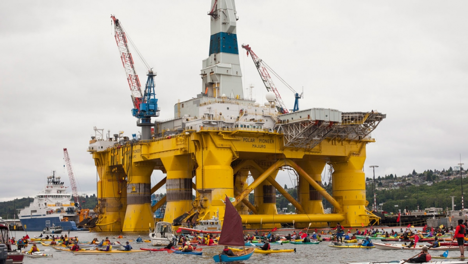Demonstrators protest against Royal Dutch Shell near the Polar Pioneer oil drilling rig on May 16, 2015, in Seattle.