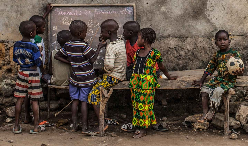 Young kids take part in informal French language lessons in the village of Meliandou, Guinea, ground zero for the West African Ebola outbreak.