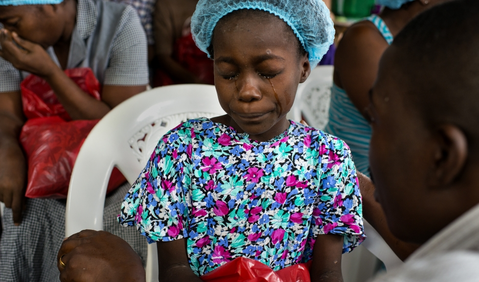 Michel du Cille's haunting photographs from the Ebola front included this one of Esther Tokpah, 11, orphaned in Monrovia, Liberia