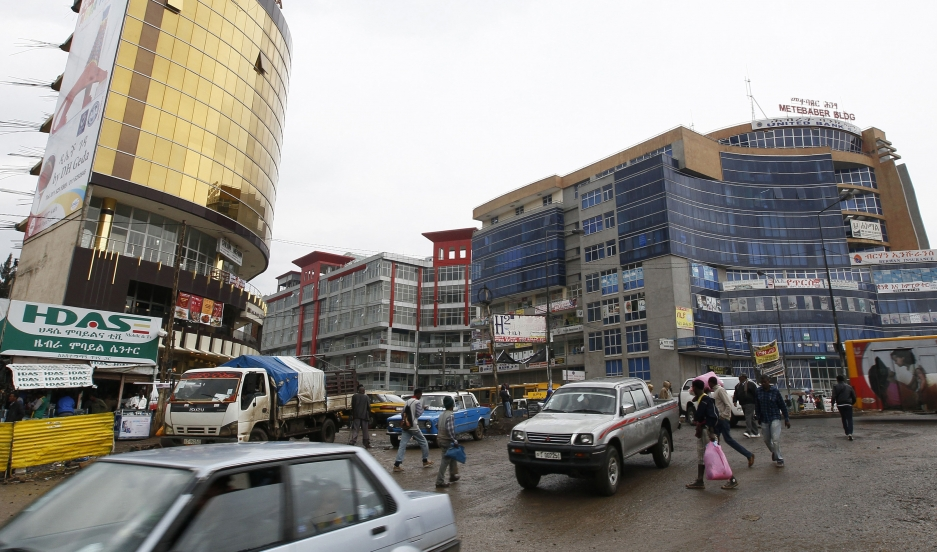 People walk through the streets of a shopping area in Addis Ababa.