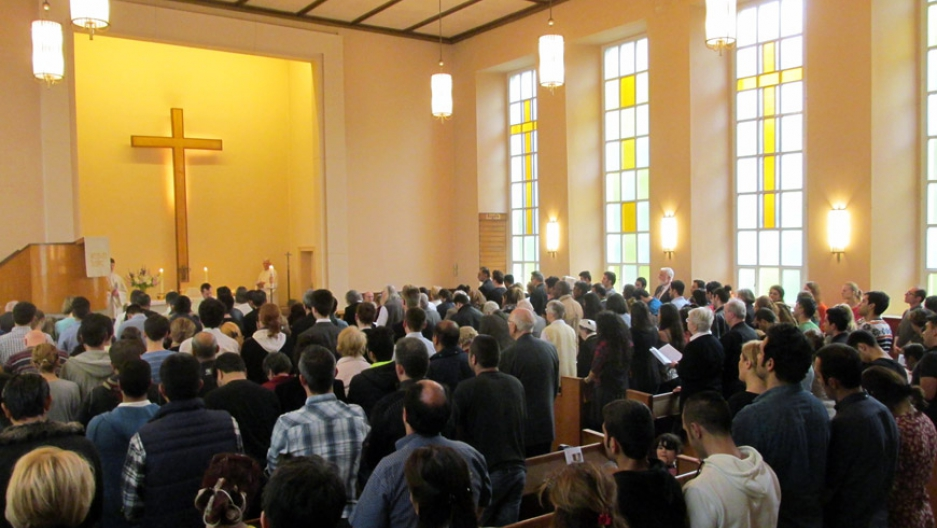 A congregation at the Evangelical Lutheran Trinity Church and Community in Berlin.