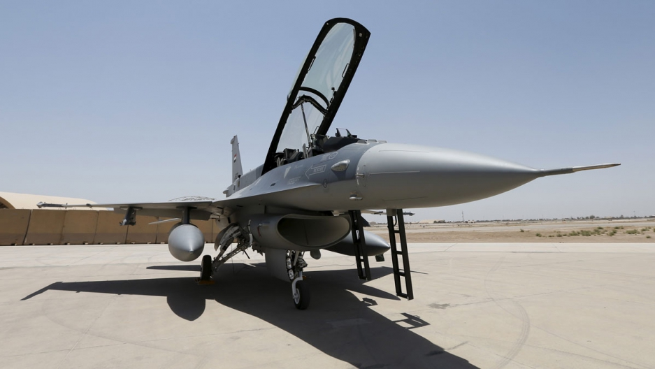 A US F-16 fighter jet at the tarmac a military base in Balad, Iraq. Temperatures in Iraq have reached 140 degrees Fahrenheit in the past year.