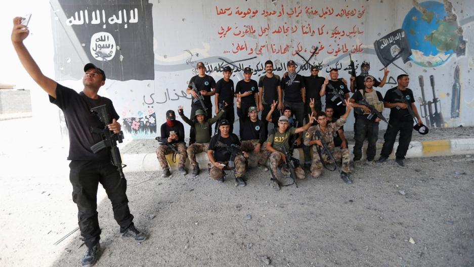 Iraqi counterterrorism forces pose for a picture in Fallujah, Iraq.