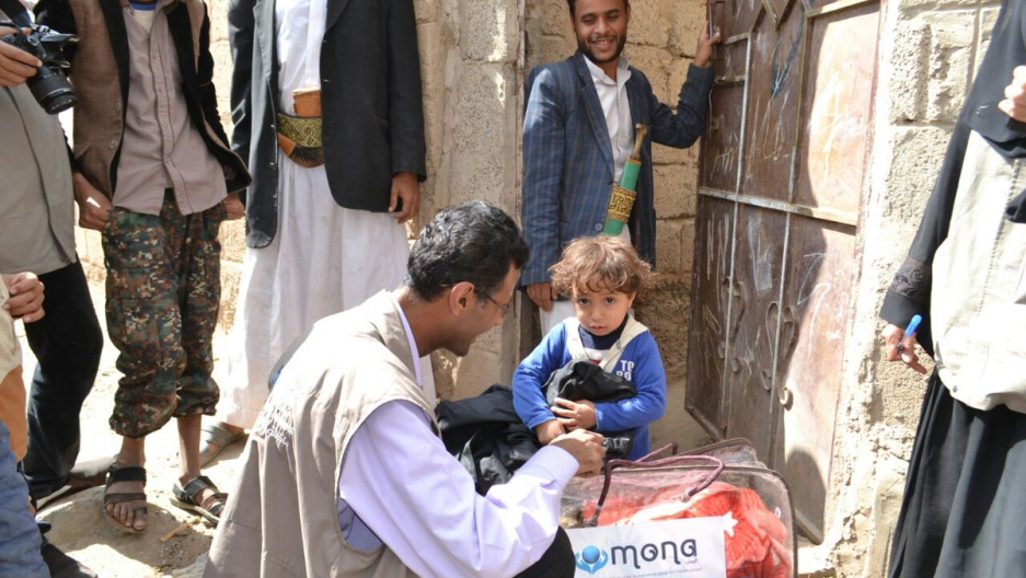 Fatik Al-Rodaini of Mona Relief, partnering with IOM - UN Migration Agency in Yemen, distributing hygiene kits and blankets to displaced families in Sanaa, December 2016