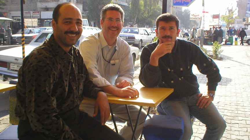 Translator extraordinaire Ayub Nuri on the right, along with reporter Aaron Schachter and their driver Abdulrazzaq Zanjeel at a street cafe in Baghdad in 2003.