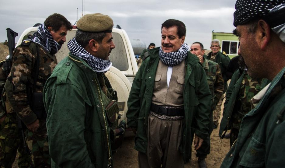 Kemal Kerkuki, commanding officer of Peshmerga forces outside of Kirkuk, speaks with his troops.