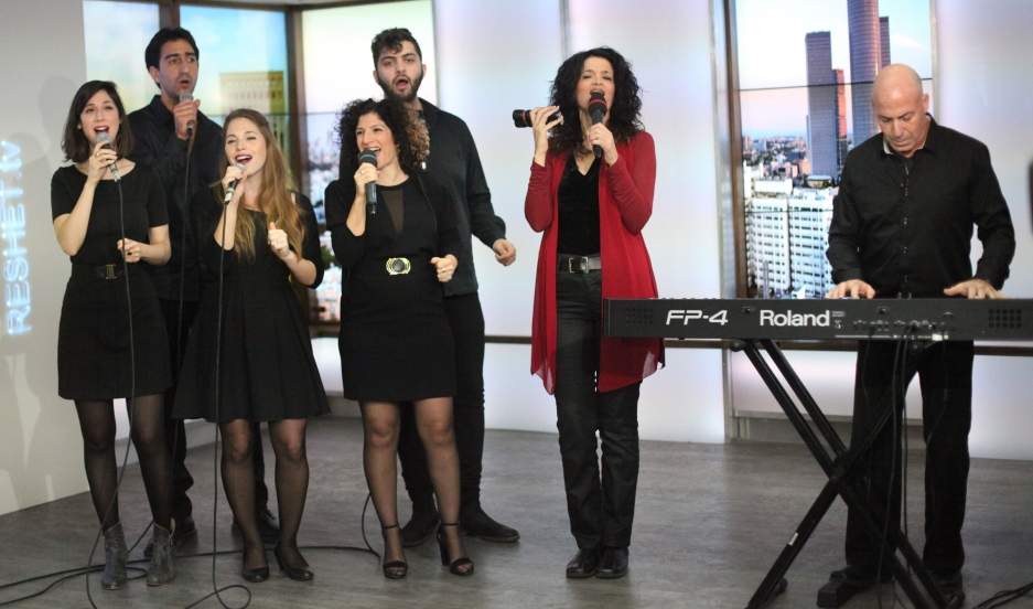 Ofer Portugaly on piano, and his wife Iris (standing next to him), started an Israeli gospel choir in 1999 after a trip to Nigeria. Here, they appear with part of their 15-member ensemble on Israeli TV.